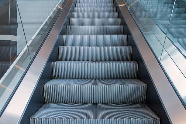 escalators stairway inside modern office building stock photo