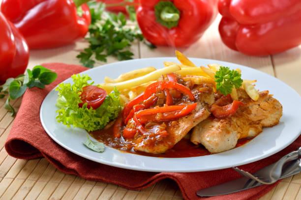 escalope of turkey - paprika hähnchen stock-fotos und bilder