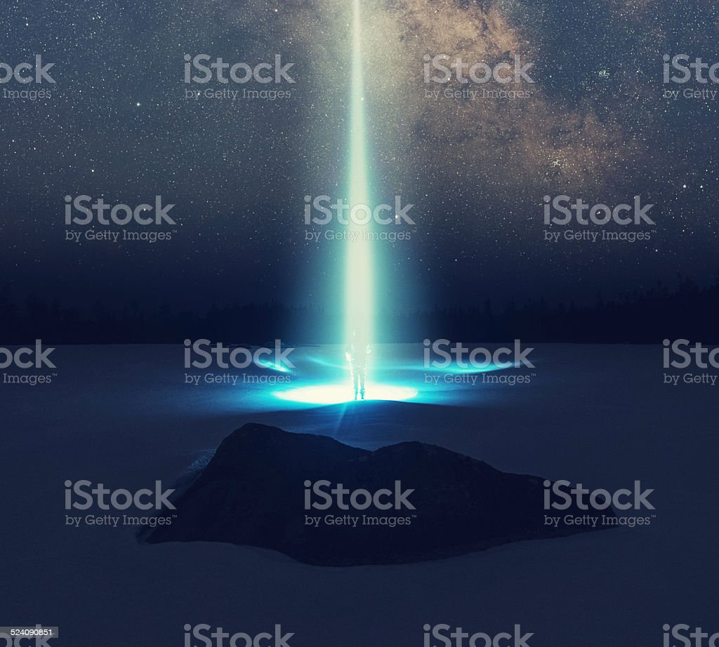 Escape to the Stars A person is beamed off the surface of a frozen lake into the stars. Composite image. Alien Stock Photo
