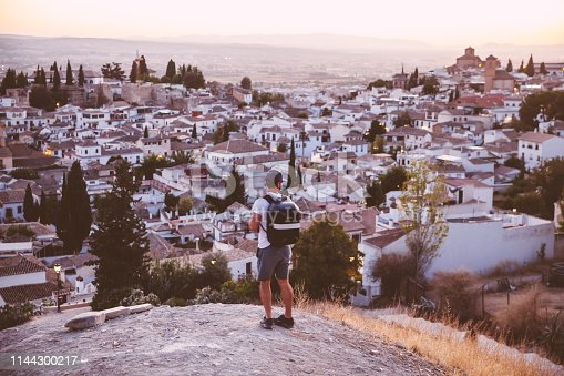 A male traveller enjoying the cityscape of Granada,Spain.