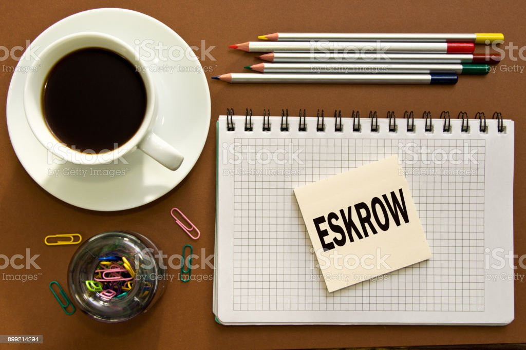 Escrow notes in the notebook on the Desk in the office Desk. Business concept eskrow. stock photo