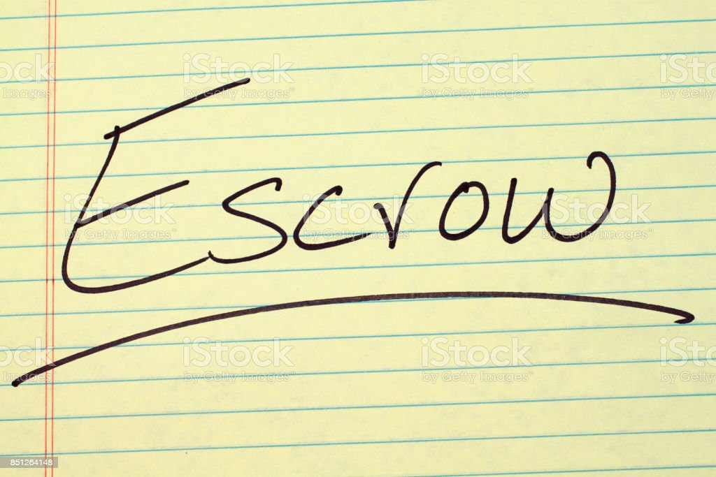 Escrow On A Yellow Legal Pad stock photo