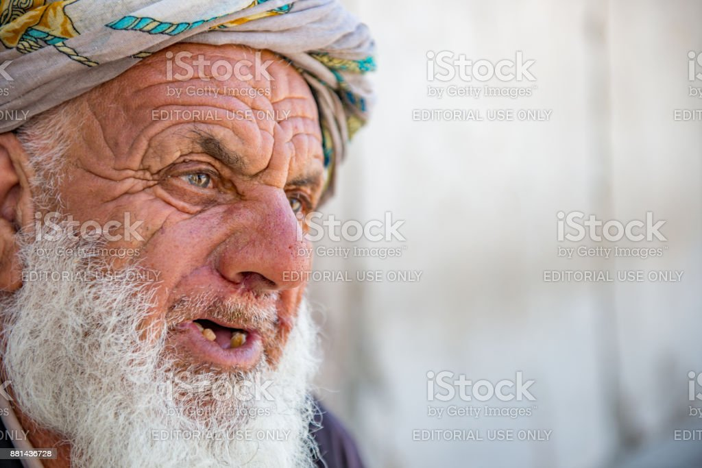 Esfahan - Iran. April 21, 2017. An old Afghan in Naqsh-e Jahan (Imam) Square stock photo