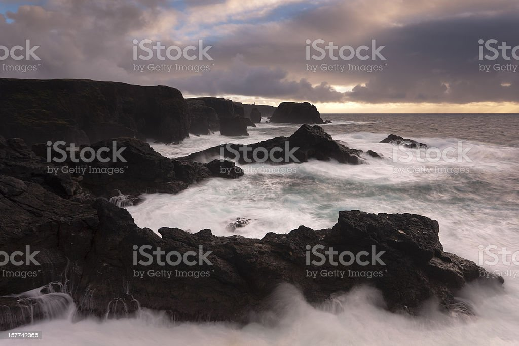 Eshaness Shetland during a gale with lighthouse in the background royalty-free stock photo