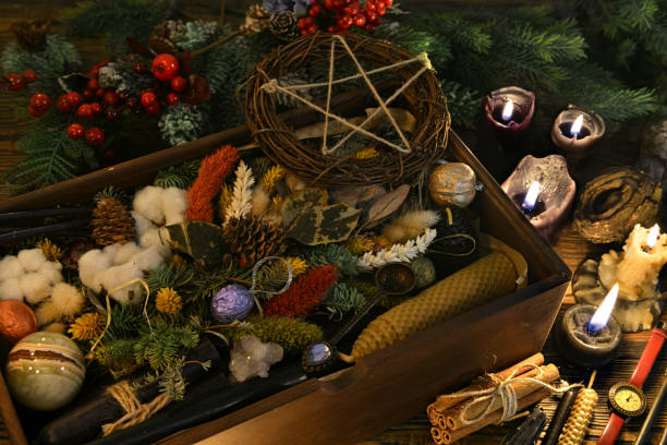 Esoteric and wicca still life with box of gifts, pentagram, candles and herbs on witch table. stock photo