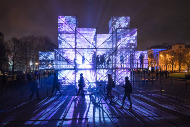 """Esplanade of Riga amidst the light festival """"Staro Riga"""". Riga, Latvia - November 20, 2017: Different violetly lit cubic installations in the Esplanade of Riga amidst the light festival """"Staro Riga"""". amidst stock pictures, royalty-free photos & images"""