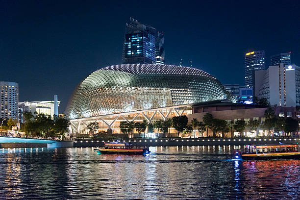 Esplanade Theatres on the Bay, Singapore Singapore, Singapore - April 15, 2016: View at the Esplanade Theatres on the Bay during the evening. The Esplanade Theatres is a 60,000 square metres performing arts center located in Marina Bay near the mouth of the Singapore River. esplanade theater stock pictures, royalty-free photos & images