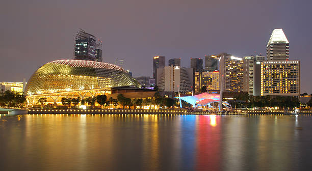 SINGAPORE - APRIL 10, 2016: Esplanade - Theatres SINGAPORE - APRIL 10, 2016: Esplanade - Theatres on the Bay is a performance and art center located in Marina Bay. It is nicknamed the Durian by the Singaporeans because of its spikey appearance. esplanade theater stock pictures, royalty-free photos & images