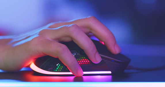 close up of pro cyber sport gamer play game with RGB mouse
