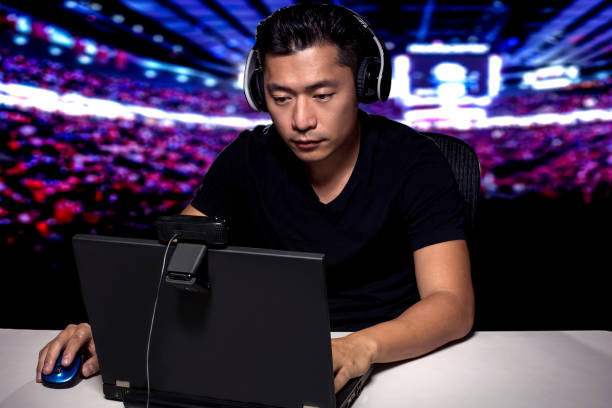 esports competitive gamer in a stadium - esports stock photos and pictures