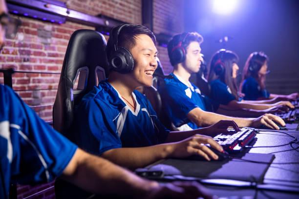 esports team playing in a tournament - esports stock photos and pictures