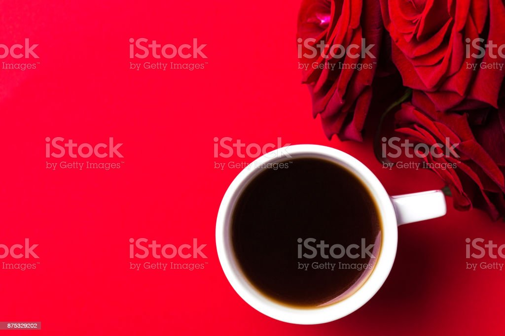 Espresso and roses on red background. Color surge. Valentine day