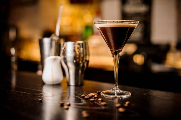 espresso cocktail drink white foam coffee bean bar inventory garnish martini espresso cocktail drink foam coffee bean on top bar counter martini stock pictures, royalty-free photos & images