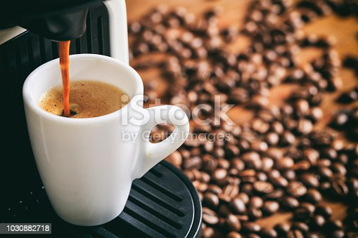 istock Espresso coffee and machine 1030882718
