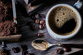 istock Espresso coffee cup on vintage table with ground and roasted coffee beans 1255958583