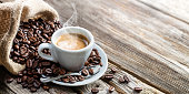 istock Espresso Coffee Cup With Beans On Vintage Table 664313320