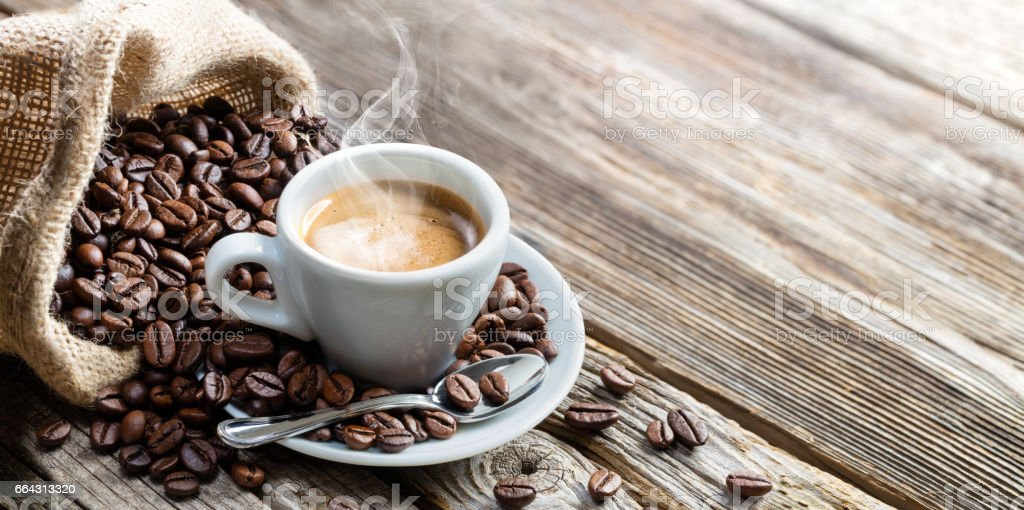 Espresso Coffee Cup With Beans On Vintage Table stock photo