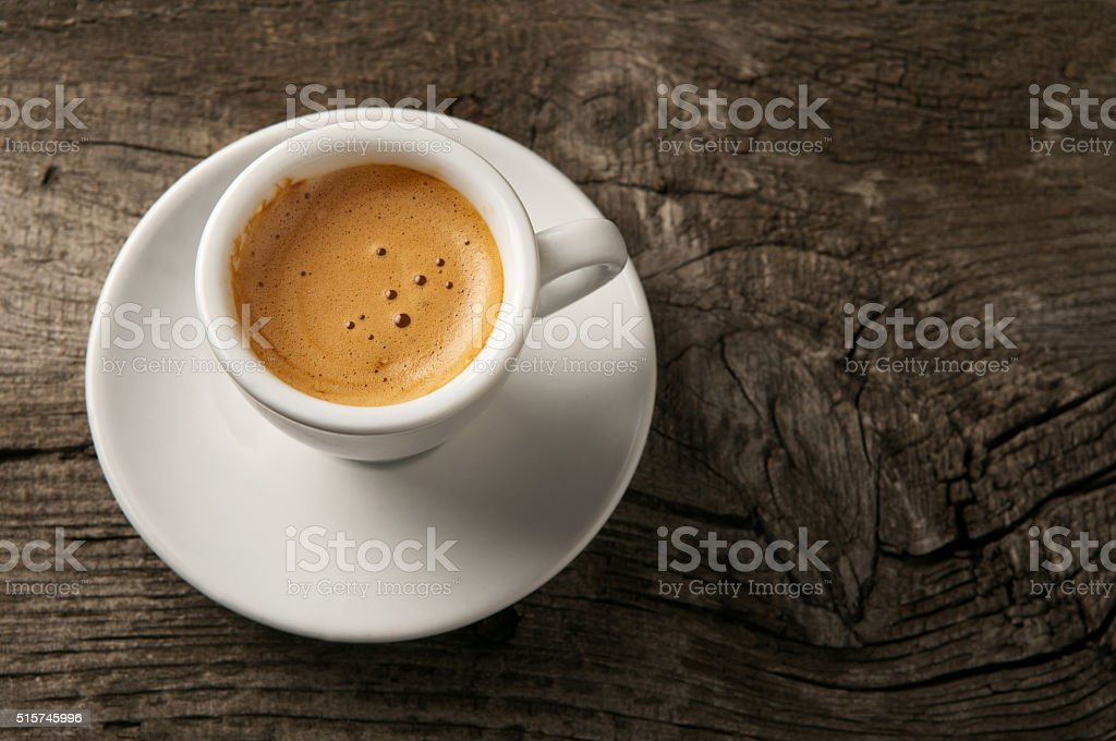 Espresso coffee cup with foam on top view stock photo