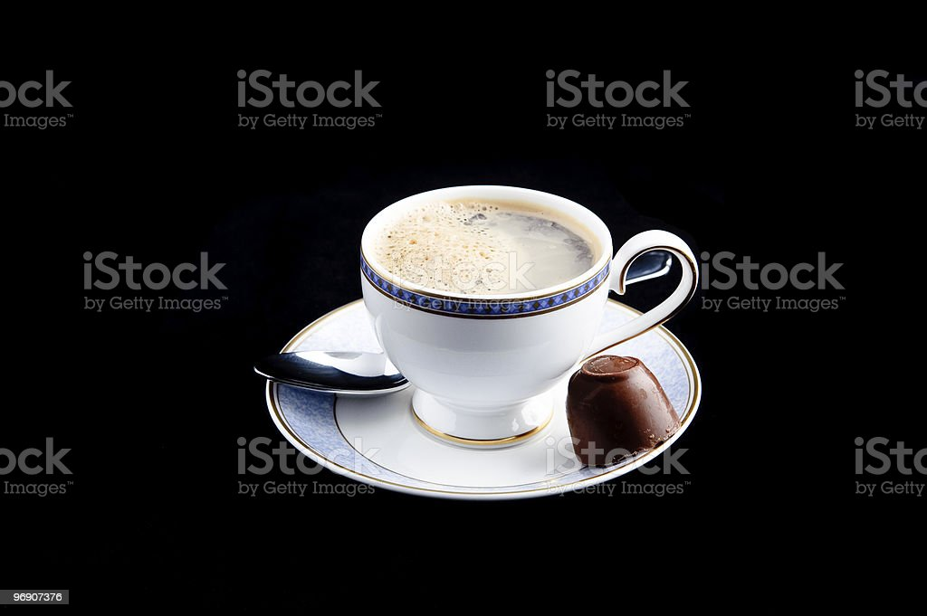 Espresso coffee cup with spoon and chocolate on saucer royalty-free stock photo