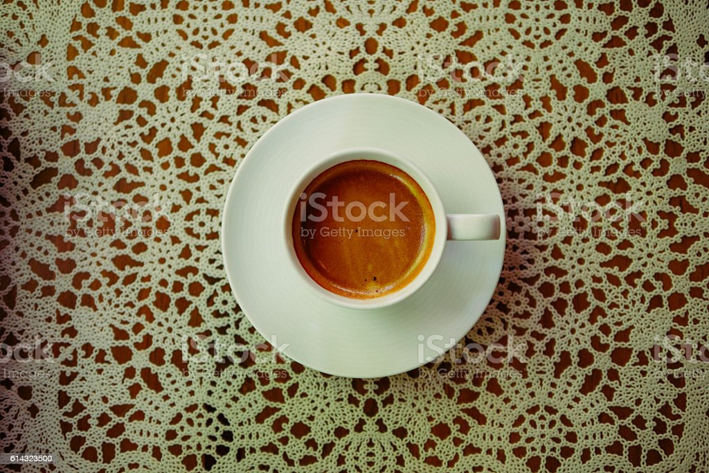 Espresso Coffee Drink in White Mug on table. top view stock photo
