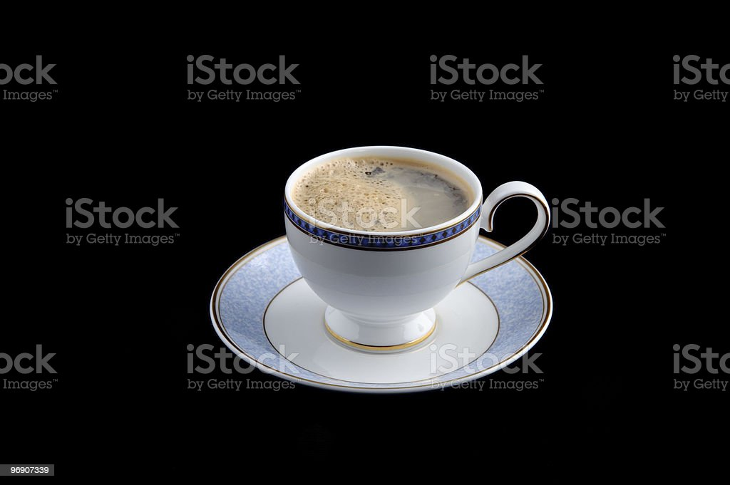 Espresso coffee in cup with saucer on black studio background royalty-free stock photo