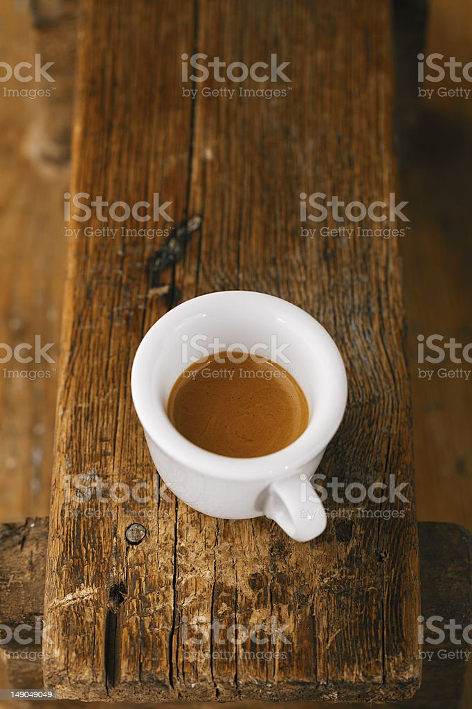 espresso coffee in thick white cup on old wooden bench royalty-free stock photo