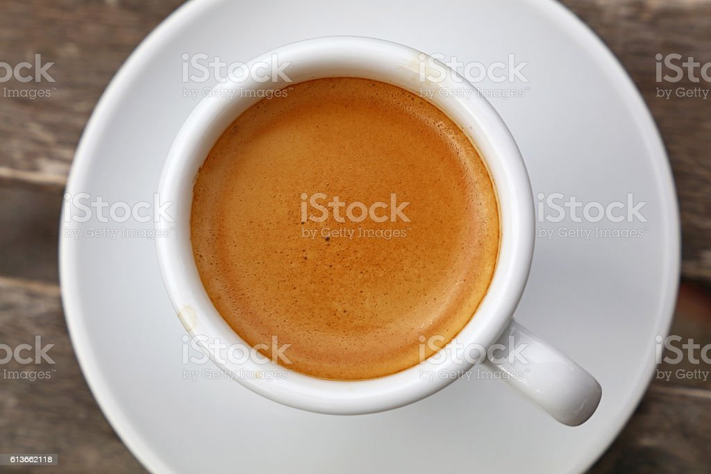 Espresso coffee in white cup close up top view stock photo