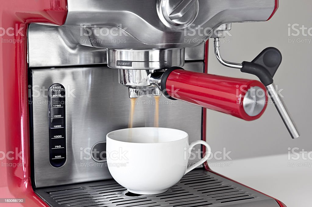 Espresso coffee machine in use stock photo
