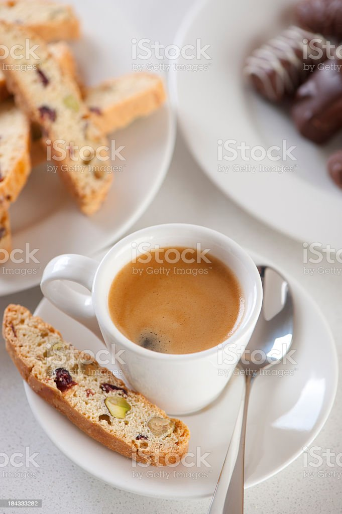 Espresso coffee with biscotti and chocolates royalty-free stock photo