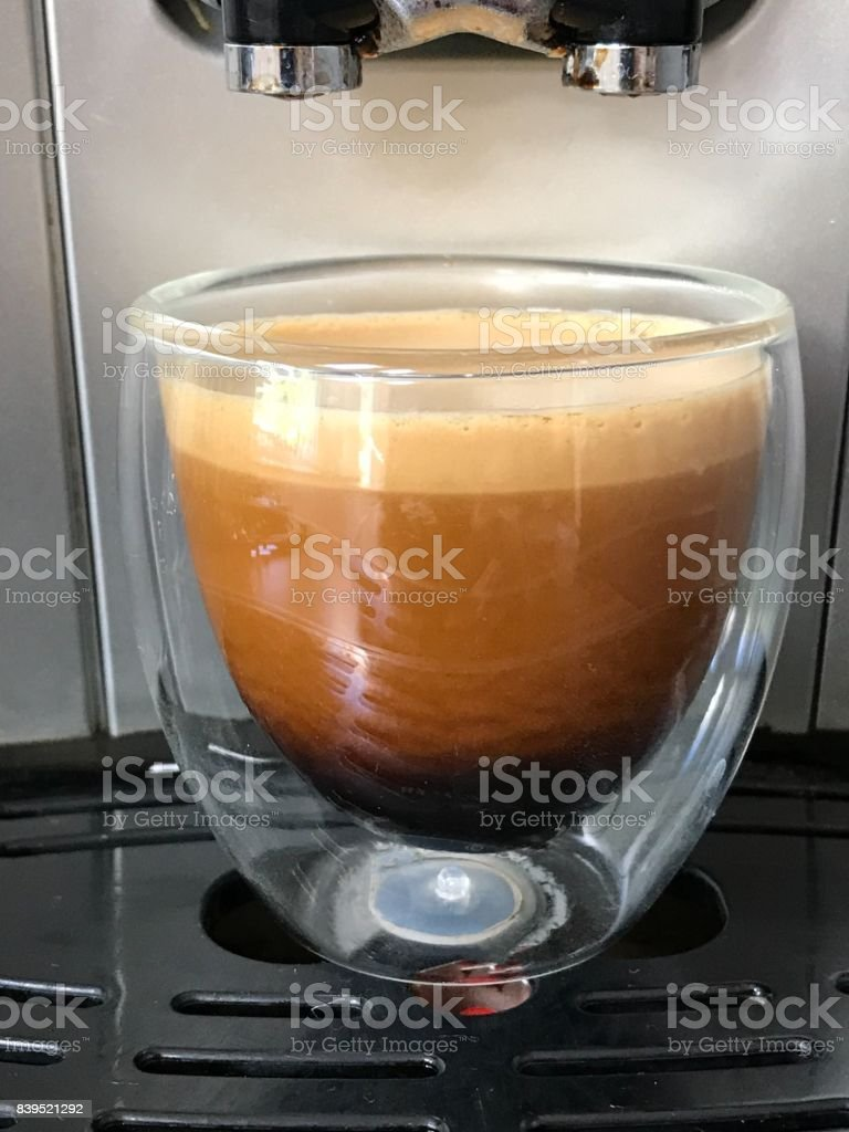 Espresso cup being filled stock photo