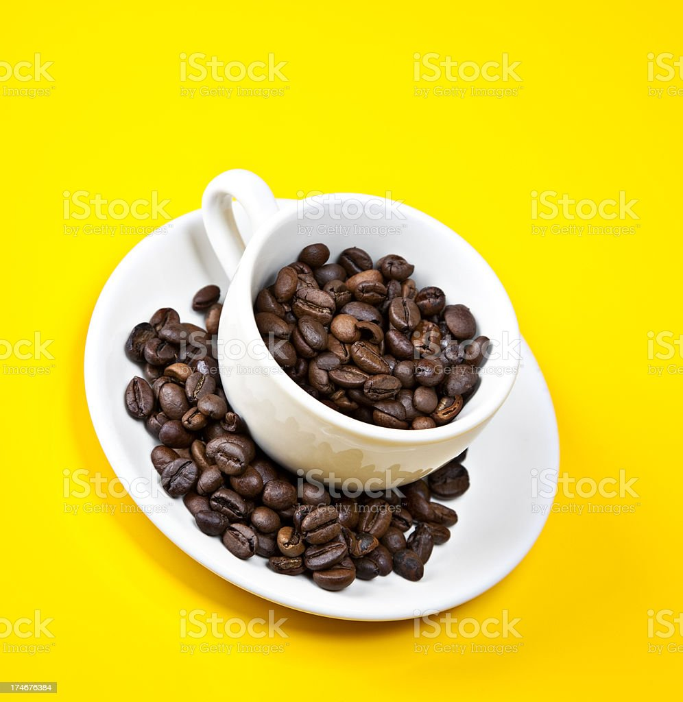 espresso cup filed with beans royalty-free stock photo