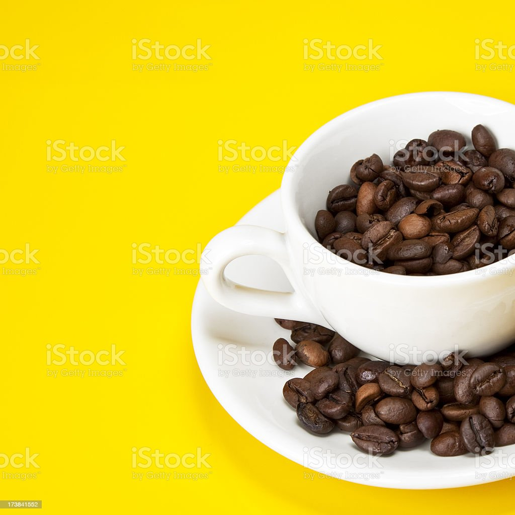 espresso cup filled with beans royalty-free stock photo
