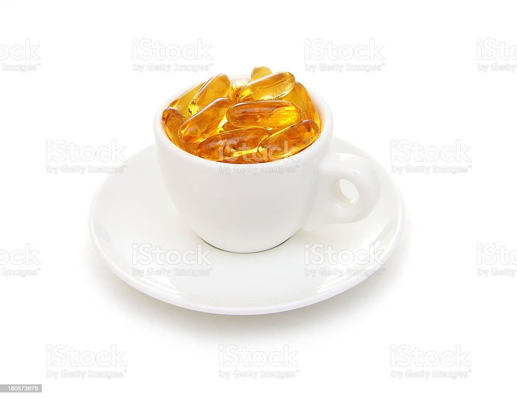 Espresso cup filled with fish oil capsules stock photo