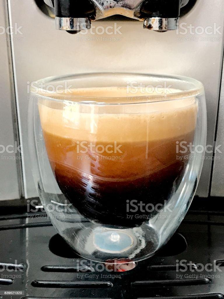 Espresso cup full of coffee. stock photo