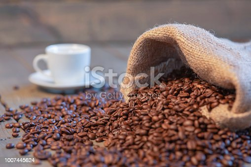 istock Espresso cup on a table with coffee 1007445624