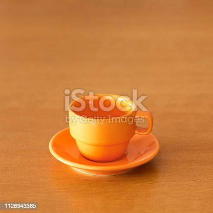 Empty espresso cups on table