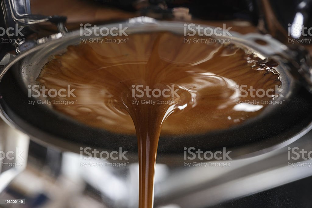 espresso extraction with bottomless portafilter stock photo