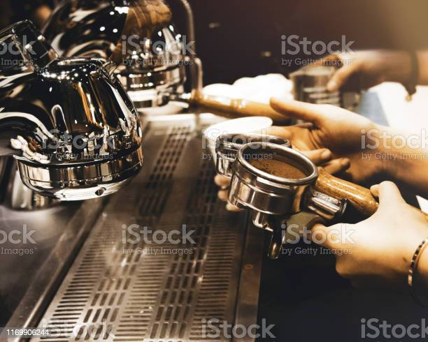 Espresso machine brewing a coffee coffee pouring into glasses in picture id1169906244?b=1&k=6&m=1169906244&s=612x612&h=fokvth4ngsqo9jg ep25nqd4ggchforo754cabnv8ru=