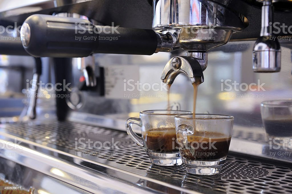 Espresso machine filling two cups of coffee stock photo