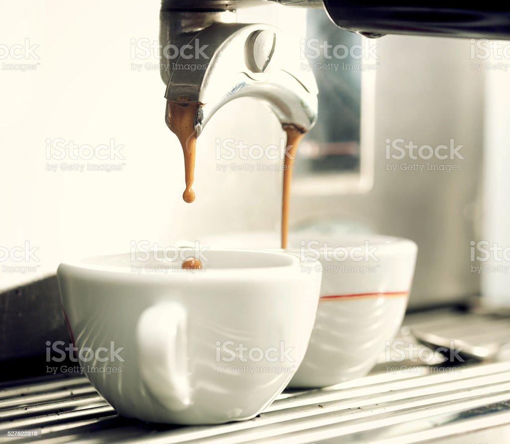 Espresso machine making a cup of coffee. stock photo