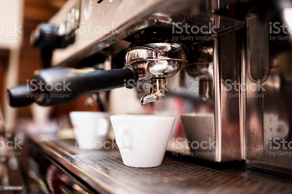 Espresso machine making coffee in pub, bar, restaurant stock photo