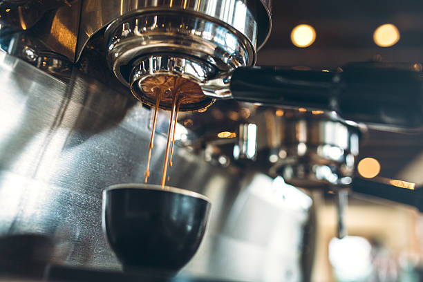 espresso machine pulling a shot - coffee maker stock pictures, royalty-free photos & images