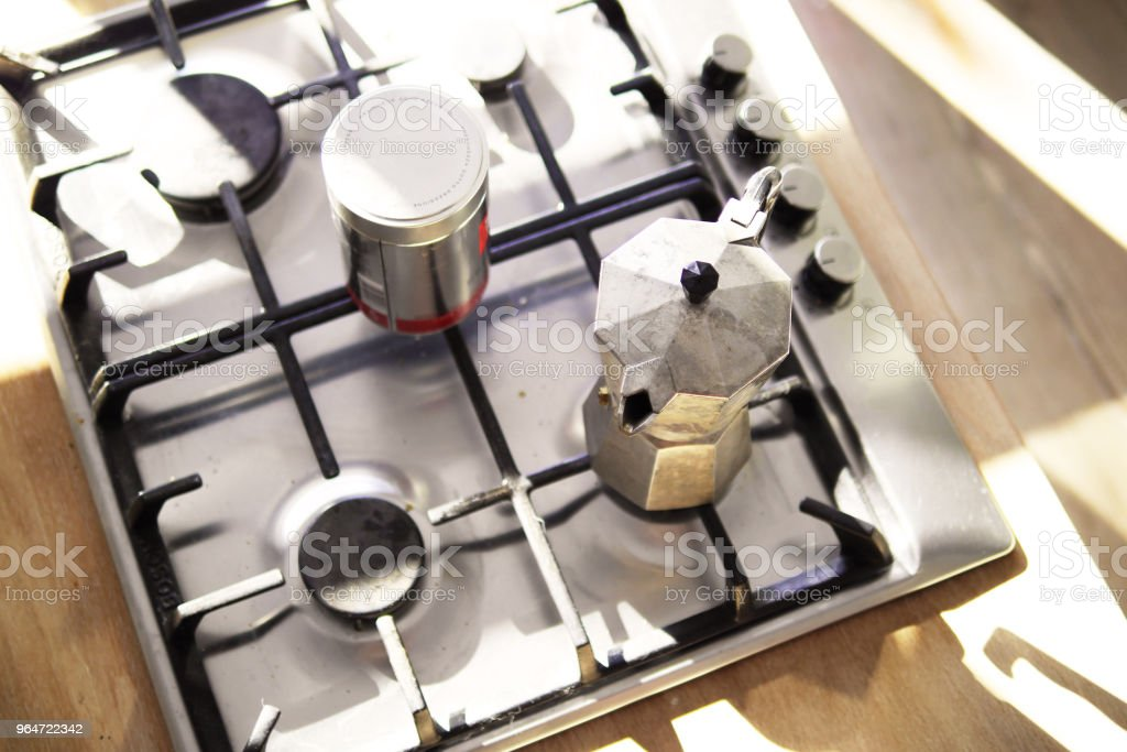 Espresso Maker and Coffee Jar on Stovetop Overhead Shot royalty-free stock photo