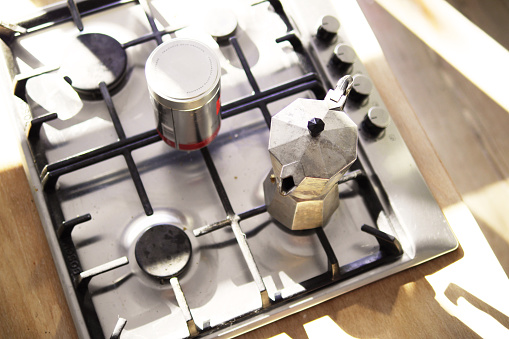 Espresso Maker and Coffee Jar on Stovetop Overhead Shot