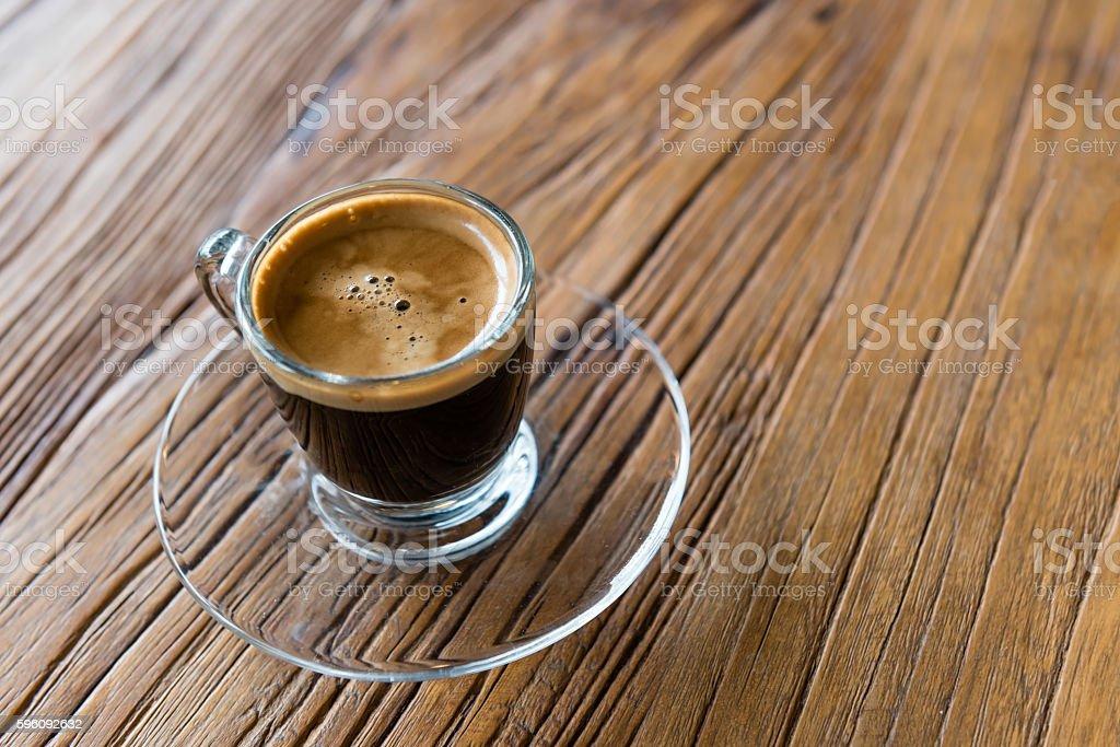 espresso shot in a glass cup on wooden table Lizenzfreies stock-foto