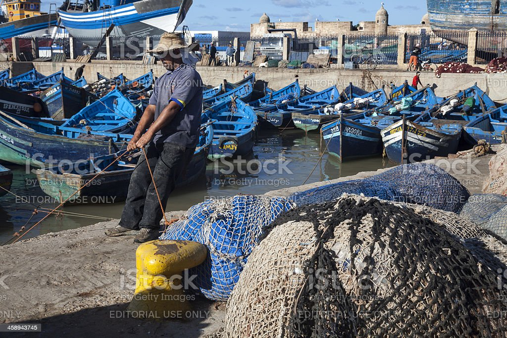 Essaouira, Morocco:  fisherman pulling his boat in royalty-free stock photo