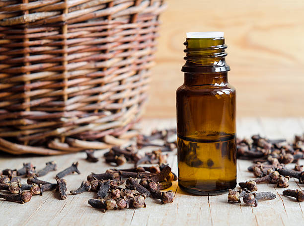 Essential clove oil Essential clove oil clove spice stock pictures, royalty-free photos & images