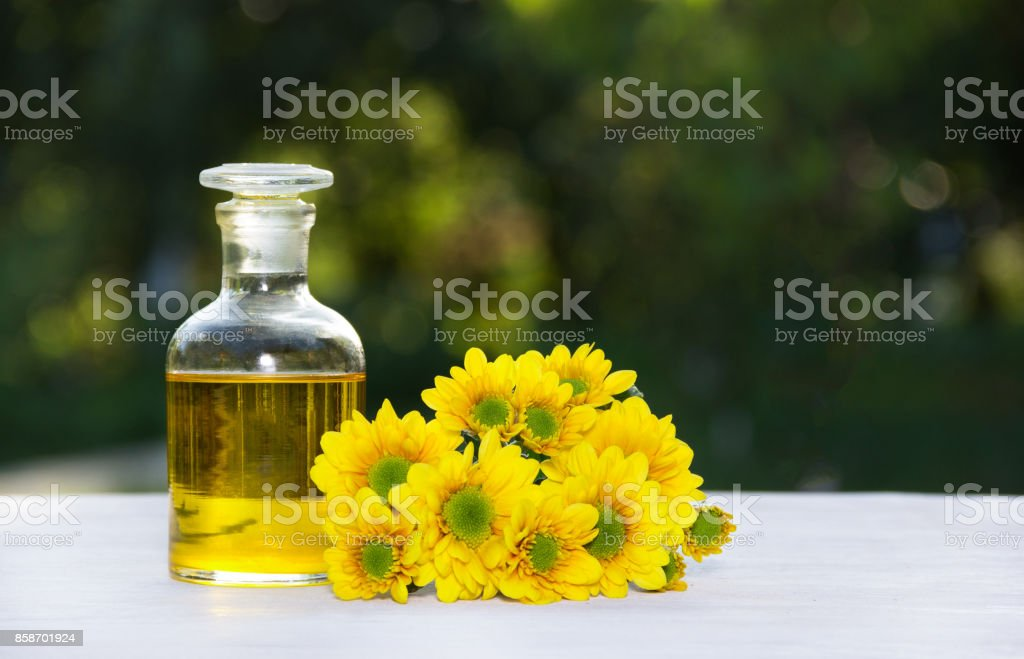 Essential floral oil. Flower elixir and fresh summer flowers. Spa and beauty care. stock photo