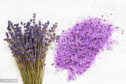istock Essential lavender bath salt and lavender flowers on wooden background. SPA lavender products. Copy space 1134774806