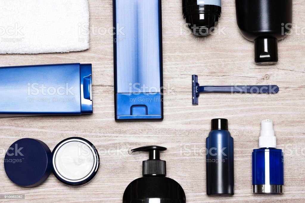 Essential male grooming products on shabby wooden surface stock photo